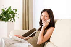 On the phone home: woman calling Stock Photo