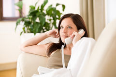 On the phone home: woman calling Royalty Free Stock Photos