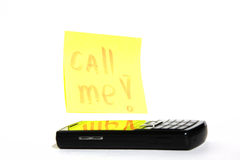 Phone and inscription call me. Inscription on a yellow paper call me, near phone Royalty Free Stock Photo