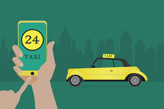 Phone with interface taxi on a screen on a background the city. Stock Photo