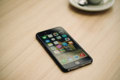 Phone 6 in the case with the included screen is on the table Royalty Free Stock Images