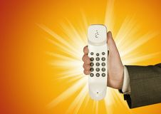 The Phone - Its For You!. The Phone - on an orange backdrop Stock Photography