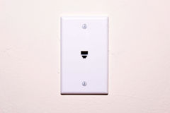 Phone jack. With white cover plate on textured wall Royalty Free Stock Photography