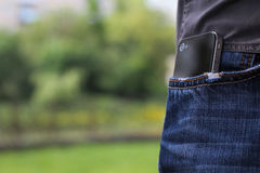 Phone in jeans pocket Stock Photography