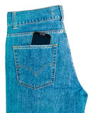 Phone in jeans pocket Royalty Free Stock Images