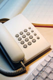 Phone and keyboard. Vertical image of phone and keyboard Stock Photos