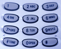 Phone Keypad. Close up of a telephone keypad in a cool blue tone Stock Images