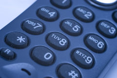 Phone keypad. Close-up of phone keypad (shallow DOF, focus on 8-button, blue tint Stock Photos