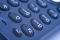 Phone keypad. Close-up of phone keypad (shallow DOF, focus on #-button, blue tint Royalty Free Stock Photography