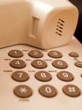 Phone keypad. Closeup of buttons on a white phone Royalty Free Stock Photo