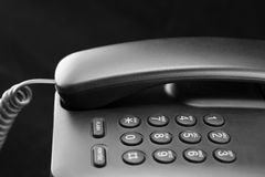 Phone keypad closeup. Black office telephone on a black background Royalty Free Stock Images