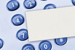 Phone keypad and paper card. Business background Stock Photos