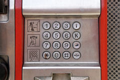 Phone keypad. Public telephone metal keypad dial Royalty Free Stock Image