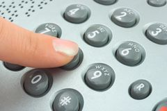 Phone keypad and woman finger Stock Image
