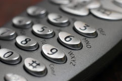 Phone keys closeup. Oval shaped keys on a cordless telephone stock image