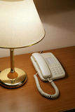 Phone and lamp Stock Images