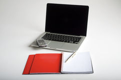 Phone, laptop and empty notebook royalty free stock images