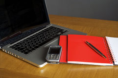 Phone, laptop and empty notebook Royalty Free Stock Image