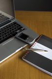 Phone, laptop and empty notebook royalty free stock photos