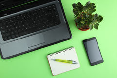 Phone, laptop, pen, notebook Royalty Free Stock Images