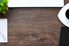 Phone, laptop, saved properties lie on a wooden table Stock Images