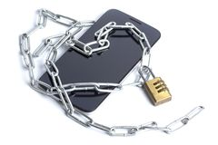 The phone lays flat on the chain and lock. The phone lays flat on the iron chain and lock royalty free stock images