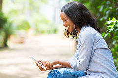 Phone listening music. Happy african american woman with smart phone listening music Stock Image