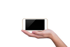 Phone lying on the hand of the girl Stock Photos