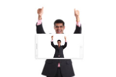 Phone makes photo of young man Stock Images