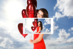 Phone makes photo of young woman Stock Image