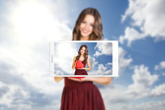 Phone makes photo of young woman Stock Photo