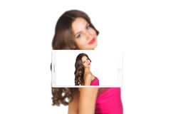 Phone makes photo of young woman Royalty Free Stock Photo