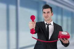 Phone. Man in suit and phone cord Royalty Free Stock Photography