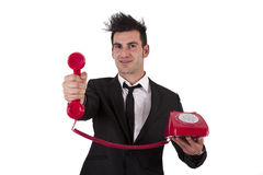 Phone. Man in suit and phone cord Royalty Free Stock Images