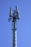 Phone mast. On blue sky Royalty Free Stock Photography