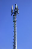 Phone mast. Against blue sky Royalty Free Stock Photos