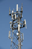 Phone mast. A phone mast against a clear blue sky stock photography