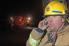 Phone message. Volunteer fire fighter relays messages on a mobile phone, Westland, New Zealand Stock Photography