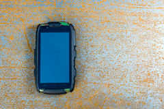 Phone on the metal sheet. Phone on rusty metal sheet Stock Photo