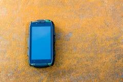 Phone on the metal sheet. Phone on rusty metal sheet Stock Photos
