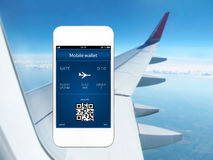 Phone with mobile wallet and plane ticket  Stock Images
