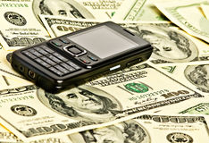 Phone on the money Stock Photo