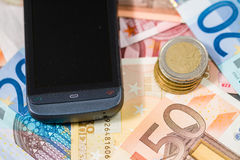 Phone and money Stock Images