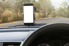 Phone and mounted holder in car on road Stock Images