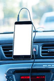 Phone and mounted holder in car on rural road. Gps stock images