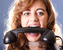 Phone in the mouth Royalty Free Stock Photography
