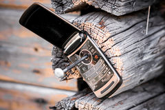 Phone nailed to the wood Royalty Free Stock Photos