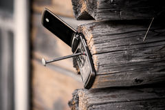 Phone nailed to the wood Royalty Free Stock Photo