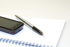 Phone on notebook Stock Photo
