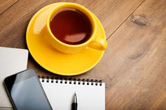 Phone,notebook, pen and cup of coffee on work tab Royalty Free Stock Image